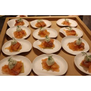 Maru Medium Round Plates filled with appetizer arranged on a table