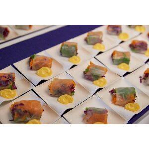 Kaku Medium Salad Plate with dessert in them arranged on a table.