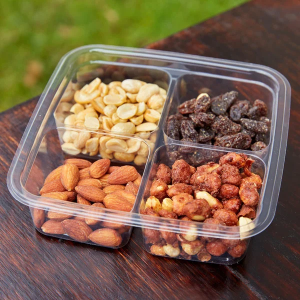 4 Compartment Clear PLA Container filled with nuts.