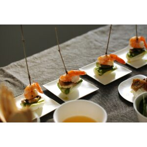 Compostable Kaku Small Tasting Plate filled with shrimps