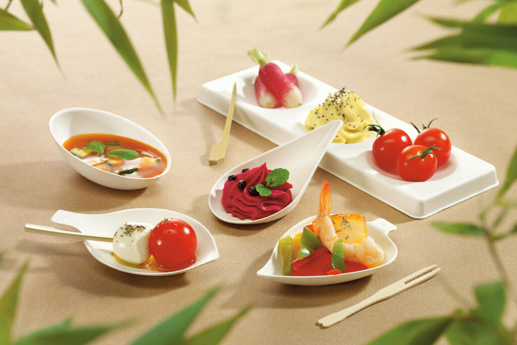 Sugarcane Pulp Plates containing dessert arranged on a table.