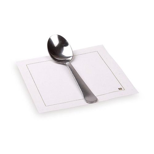 A compostable spoon on a Disposable Cotton Cocktail Napkin.