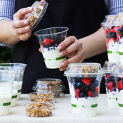 Eco-friendly Portion Cups and Parfait Cups filled with ice cream and berries.